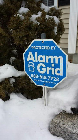 Alarm Grid Sign in the New England Snow